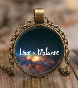 long-distance gifts for boyfriend | love is greater than distance pendant necklace