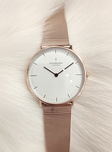 Nordgreen rose gold watch with white dial on white background